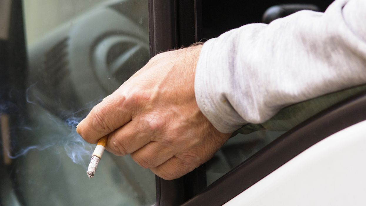 Photo Of STM Bus Driver Caught Illegally Smoking On Moving Bus