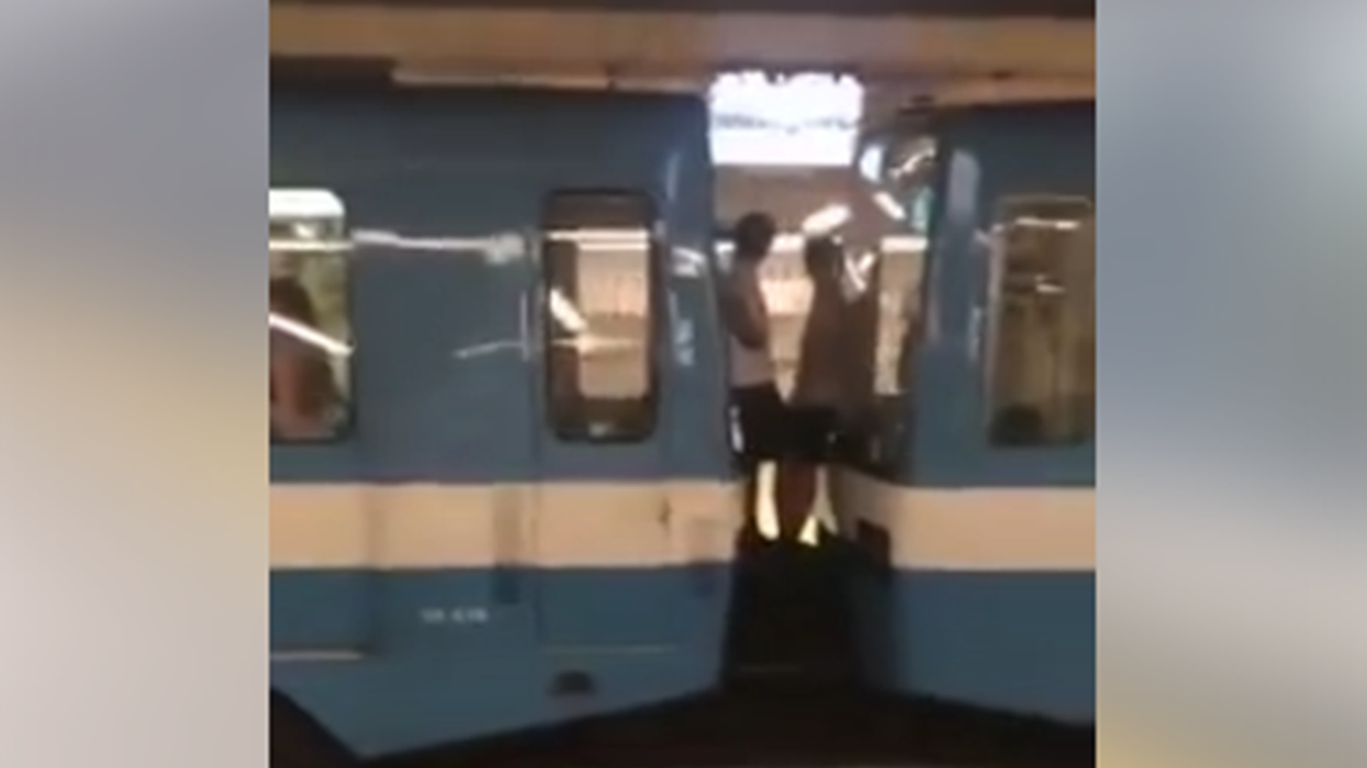 Video Showing Crazy Guys Riding Between Two Montreal STM Metro Cars