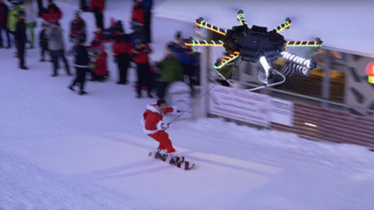 """Watch The World's First-Ever """"Human-Carrying Drone"""" Lift Snowboarder Off A Mountain"""
