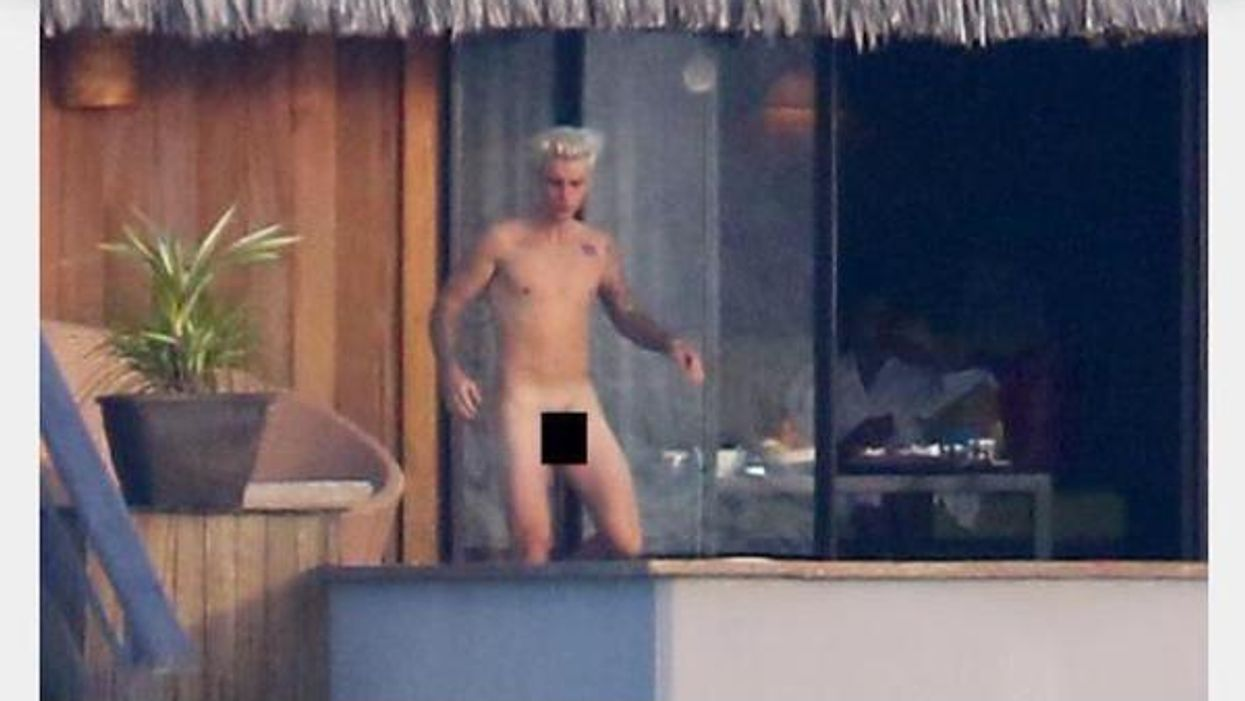 Justin Bieber Gets Caught Swimming Completely Naked