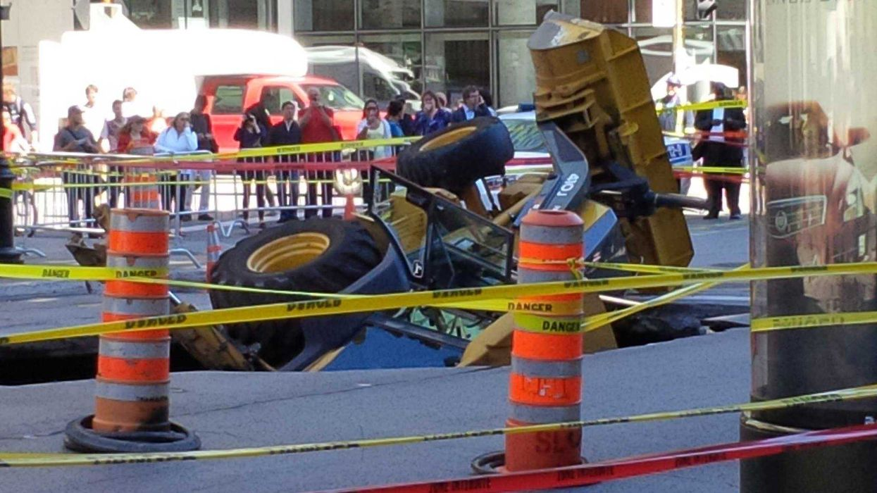 Extreme Pothole In Downtown Montreal Swallows Truck