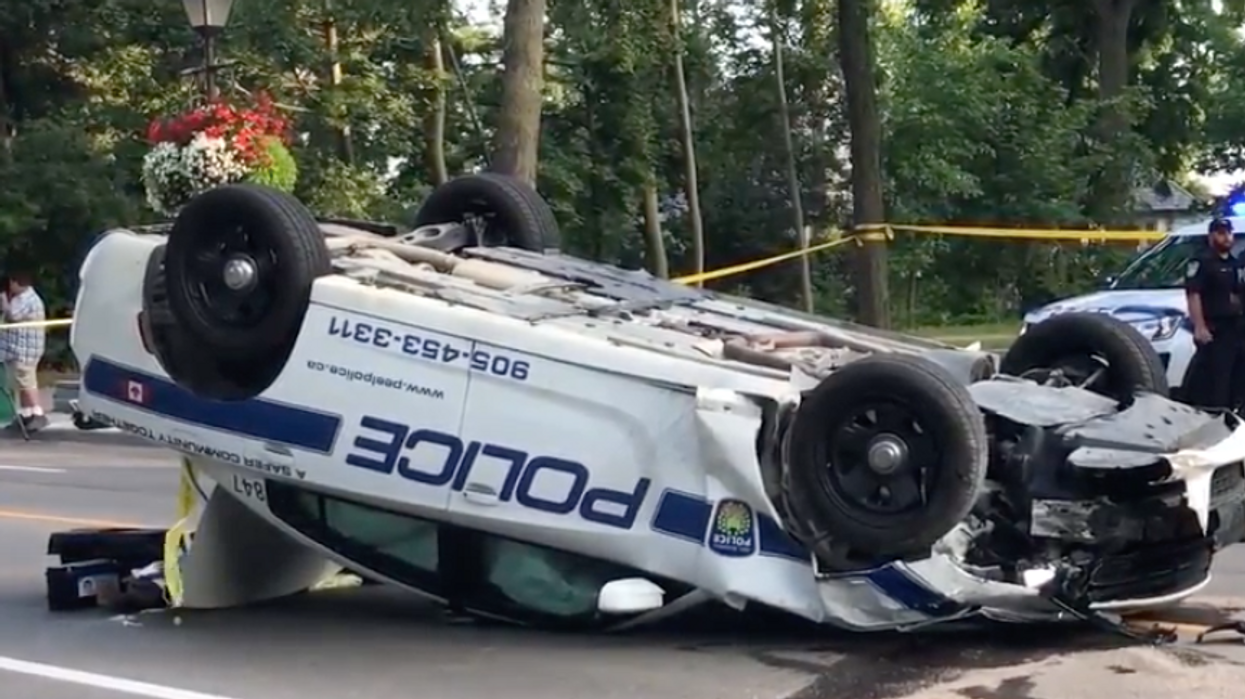 Quebec Truck Driver Crushes Police Car, With Another Car